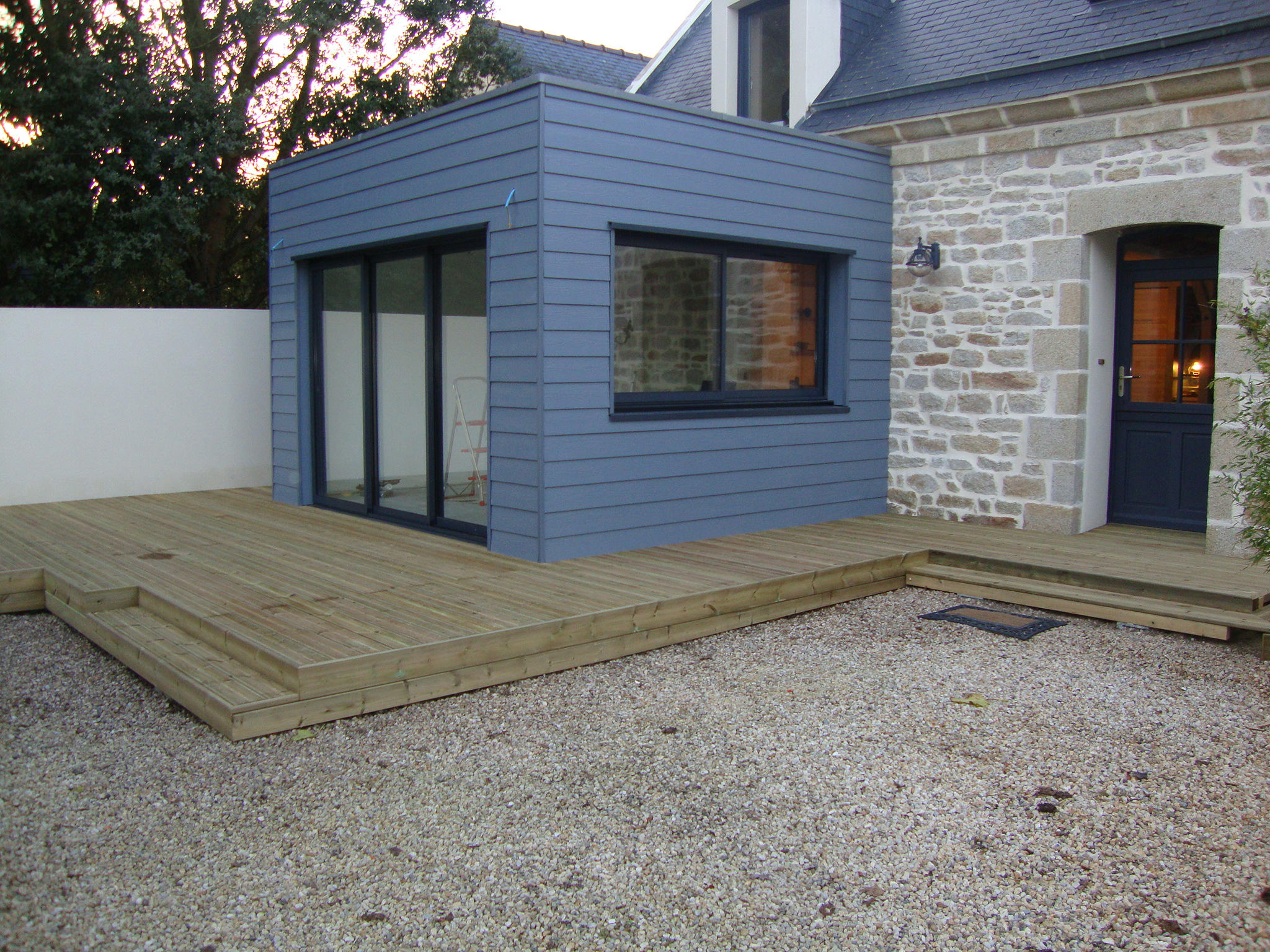 Menuiserie ossature et terrasse bois asm cr ation for Pose pare pluie bardage